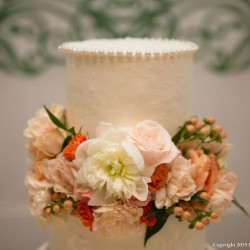 Summer Wedding Cake | Tiered White Wedding Cake with Coral and Peach Flower Accents