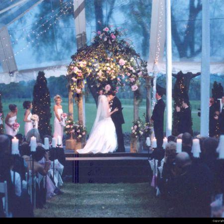 Spring Wedding Chuppah   Traditional Chuppah with Pink Roses, Chandelier, and Greenery