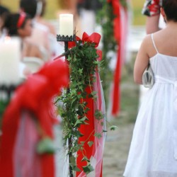 Red Summer Aisle Decorations with Candles and Hanging Vines