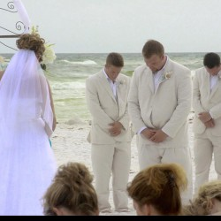 Summer Beach Destination Wedding | Khaki Groomsmen Suits | Bride and Groom in Prayer