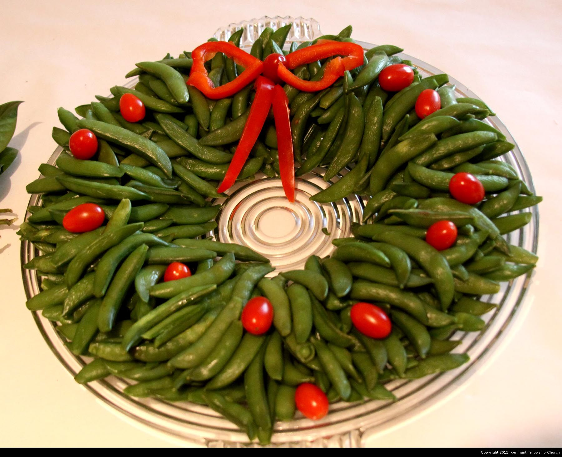 Winter Wedding Reception Food | Snow Pean Wreath and Cherry Tomato Roses