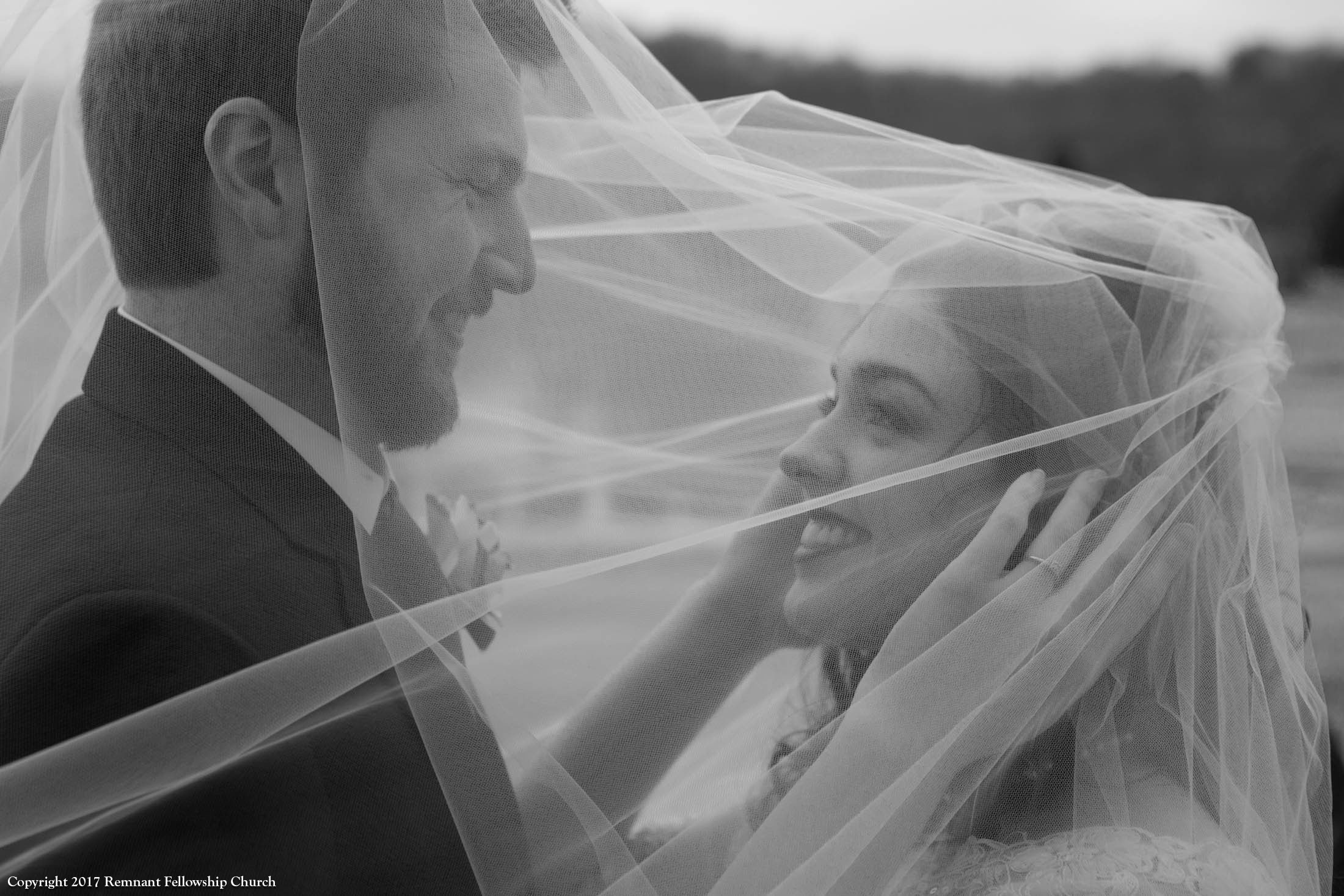Remnant-Fellowship-Theisen-Wright-Wedding-Bride-Groom-Vail-over-Heads-BW