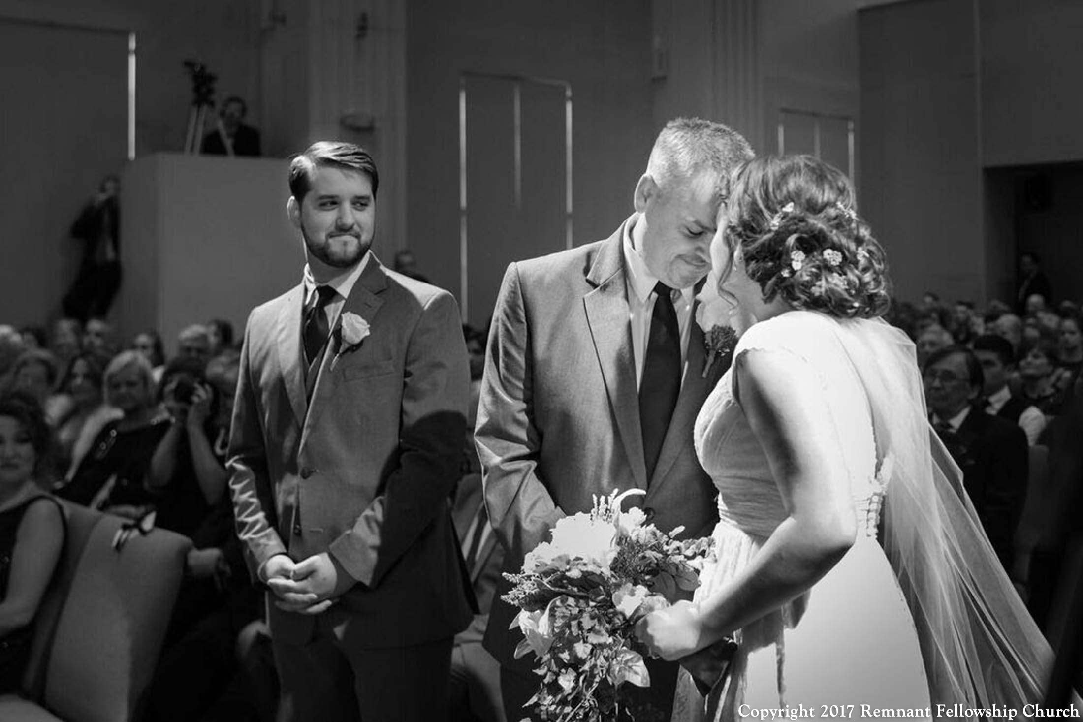 Gadke-Holmes-Remnant-Fellowship-Wedding-Bride-and-Groom-with-Father-of-Bride